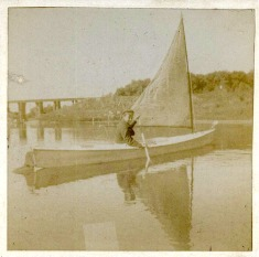 Boy on small sailboat near Grainwood c1899